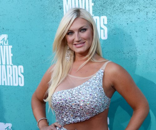 Brooke Hogan uses poetry to defend father Hulk against racism allegations