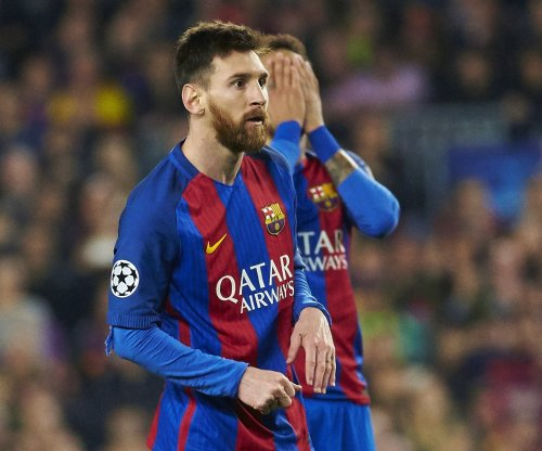 Barcelona re-signs 'the best player in history' Lionel Messi