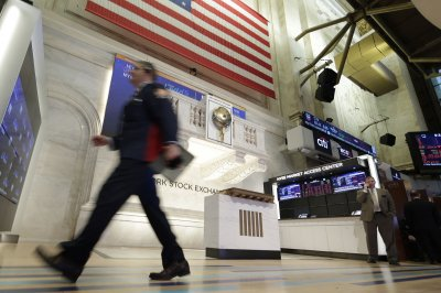 Dow sinks 1,861 points amid rise of COVID-19 cases