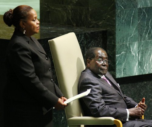 Zimbabwe President Robert Mugabe returns amid rumors of health scare