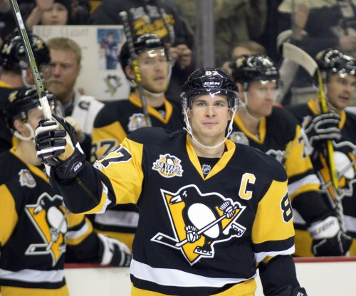 Pittsburgh Penguins' Sidney Crosby gets 1,000th point in win over Jets