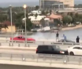 Mustang doing donuts blocks busy Florida bridge