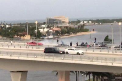 Mustang doing donuts blocks busy Florida bridge