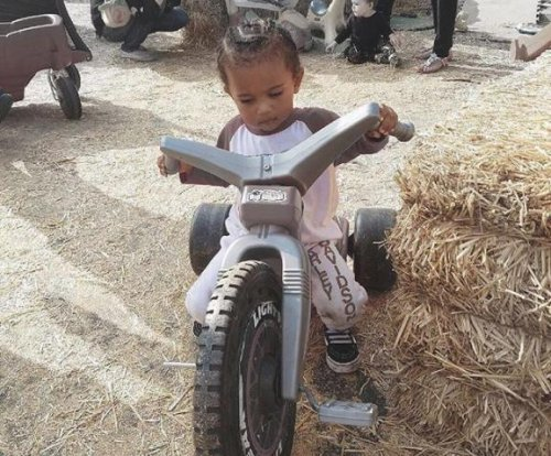 Kim Kardashian shares photo of Saint West riding tricycle