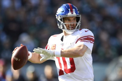 Giants try to put bump in Cowboys' road to playoffs
