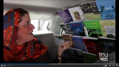 Iranian couple uses taxi as mobile bookstore