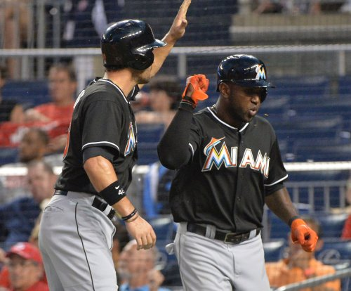 Marcell Ozuna's 3-run homer lifts Miami Marlins over Colorado Rockies