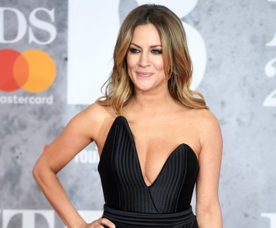Officials rule Caroline Flack's death a suicide by hanging