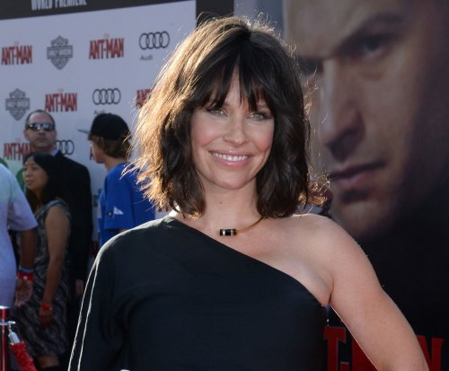 Evangeline Lilly reveals she's pregnant at 'Ant-Man' premiere