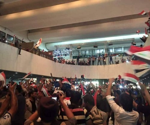 Reports: Protesters storm Iraqi parliament, use barbed wire to contain lawmakers