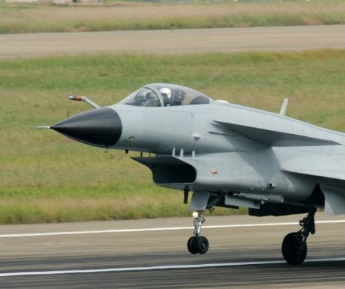 Chinese jets buzz U.S. plane in near-collision over East China Sea