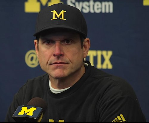 Jim Harbaugh, Ezekiel Elliott trade jabs in Ohio State, Michigan rivalry