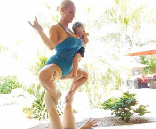 Coco Austin practices yoga with sister, daughter Chanel