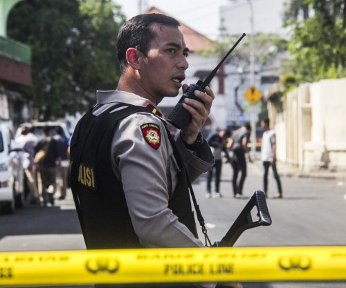Family of suicide bombers hits police headquarters in Indonesia