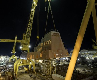 Huntington Ingalls lifts 320-ton deckhouse onto USS Jack H. Lucas