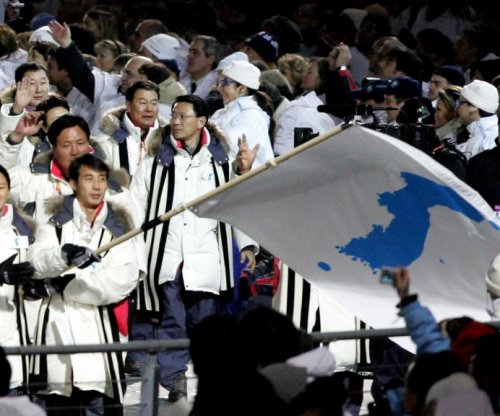 North, South Korea to march together in Olympics opening ceremony