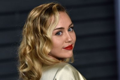Miley Cyrus teases new single with Mark Ronson