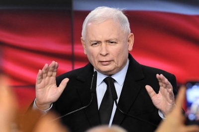 Poland's ruling party keeps lower house, loses upper chamber