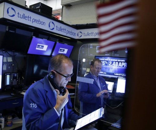 Dow falls nearly 100 points as 10-year treasury yield dips