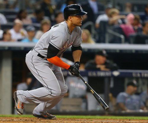 Giancarlo Stanton, Marcell Ozuna, Miami Marlins earn split with Washington Nationals