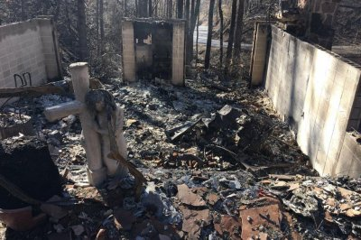 Death toll in Tennessee up to 11 as rain dampens wildfires