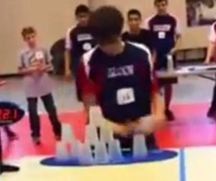 Cup stacking champ breaks record in under 5 seconds
