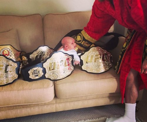 Baby Notorious: Conor McGregor shows off infant with title belts