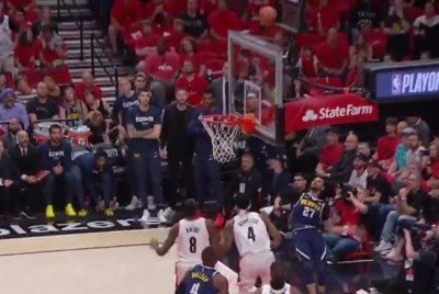Denver Nuggets' Jamal Murray swishes impossible shot from behind backboard