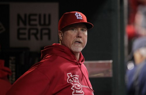 McGwire out as Cards' hitting coach