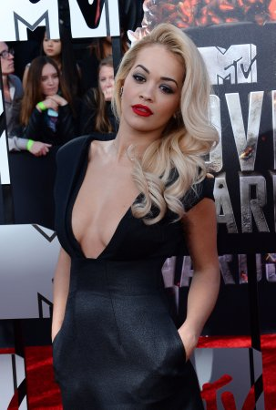 Rita Ora signs deal with Roberto Cavalli