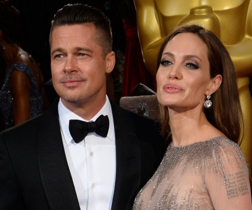 Brad Pitt on being directed by wife Angelina Jolie: 'she's knife-sharp, sexy'