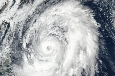 Typhoon Lan barrels toward Japan, delays election count
