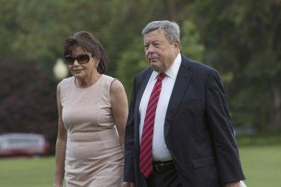 Melania Trump's parents take citizenship oath