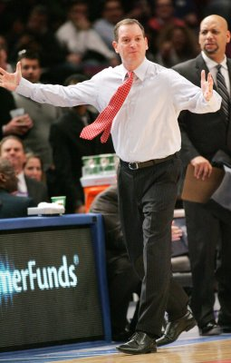 Rutgers suspends basketball coach