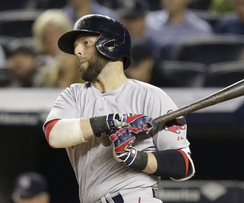 Boston Red Sox second baseman Dustin Pedroia out of starting lineup vs. Royals