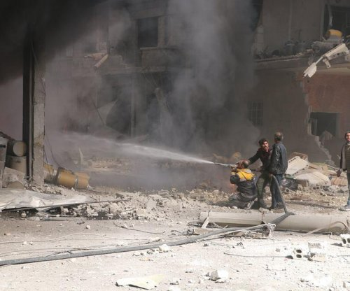 Dozens killed in land, air attacks on Syrian enclave