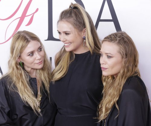 Elizabeth Olsen joins Mary-Kate and Ashley at CFDA Awards