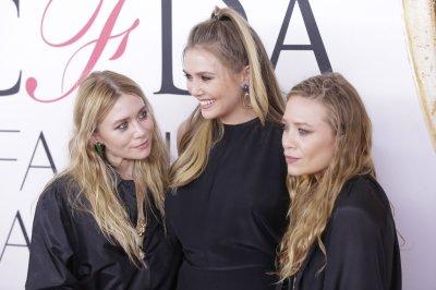 Elizabeth Olsen joins Mary-Kate and Ashley at CFDA Awards