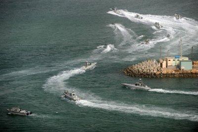 Iran backs off strait closure threat