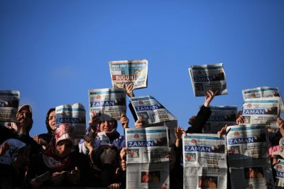 Turkish police raid Zaman newspaper after government acquisition