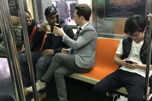 'Peak NYC:' Subway strangers share a toast after bottle of wine rolls out from seat