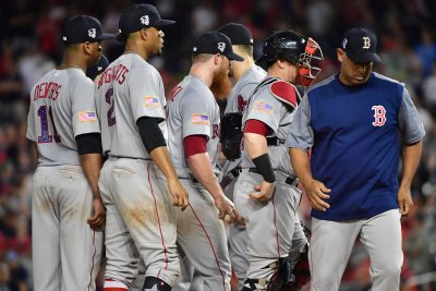 Philadelphia Phillies host Boston Red Sox while battling Atlanta Braves
