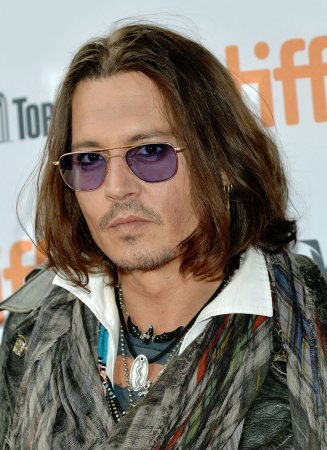 Johnny Depp performs with Alice Cooper in LA