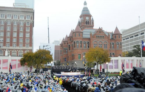 Somber skies, rain greet thousands in Dallas for Kennedy tribute