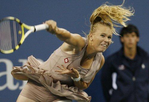 Wozniacki very sharp in second-round win