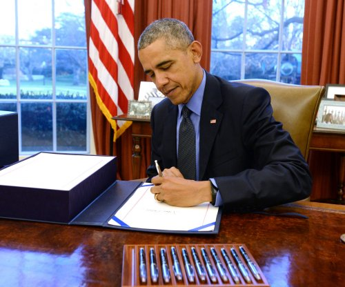 Obama signs $1.1T omnibus spending bill into law before departing on holiday break