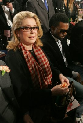 Audience loudly pans Deneuve reading