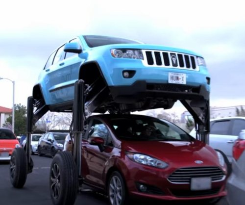 Effects company's hydraulic SUV drives over traffic