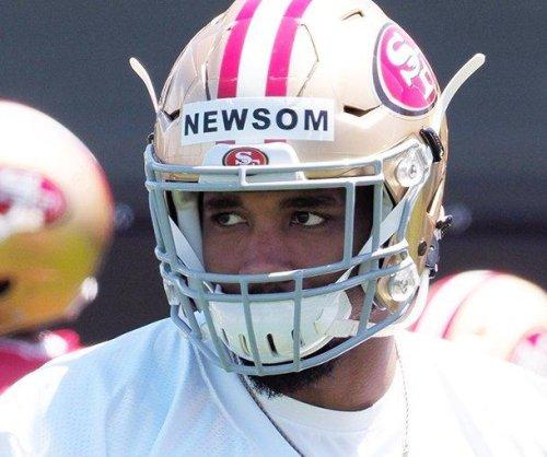 San Francisco 49ers LB Donavin Newsom taken to hospital after collision