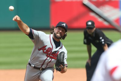 Atlanta Braves' options: Yes to C Tyler Flowers, no to pitcher R.A. Dickey